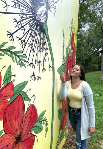 Woman in front of Hagley Mural